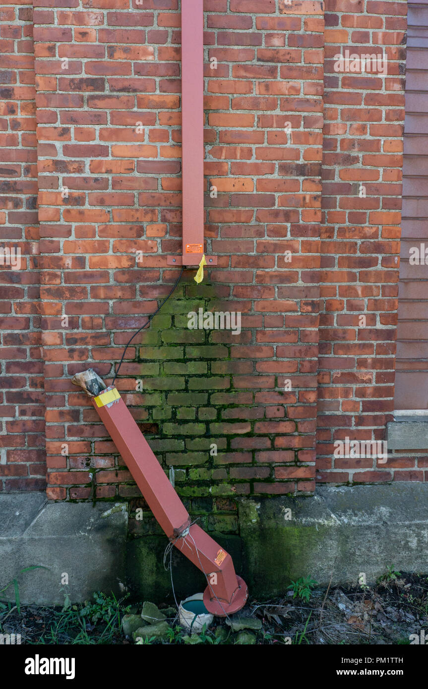 Gross irrigation gutter system thats fallen apart and grown some mold - Stock Image