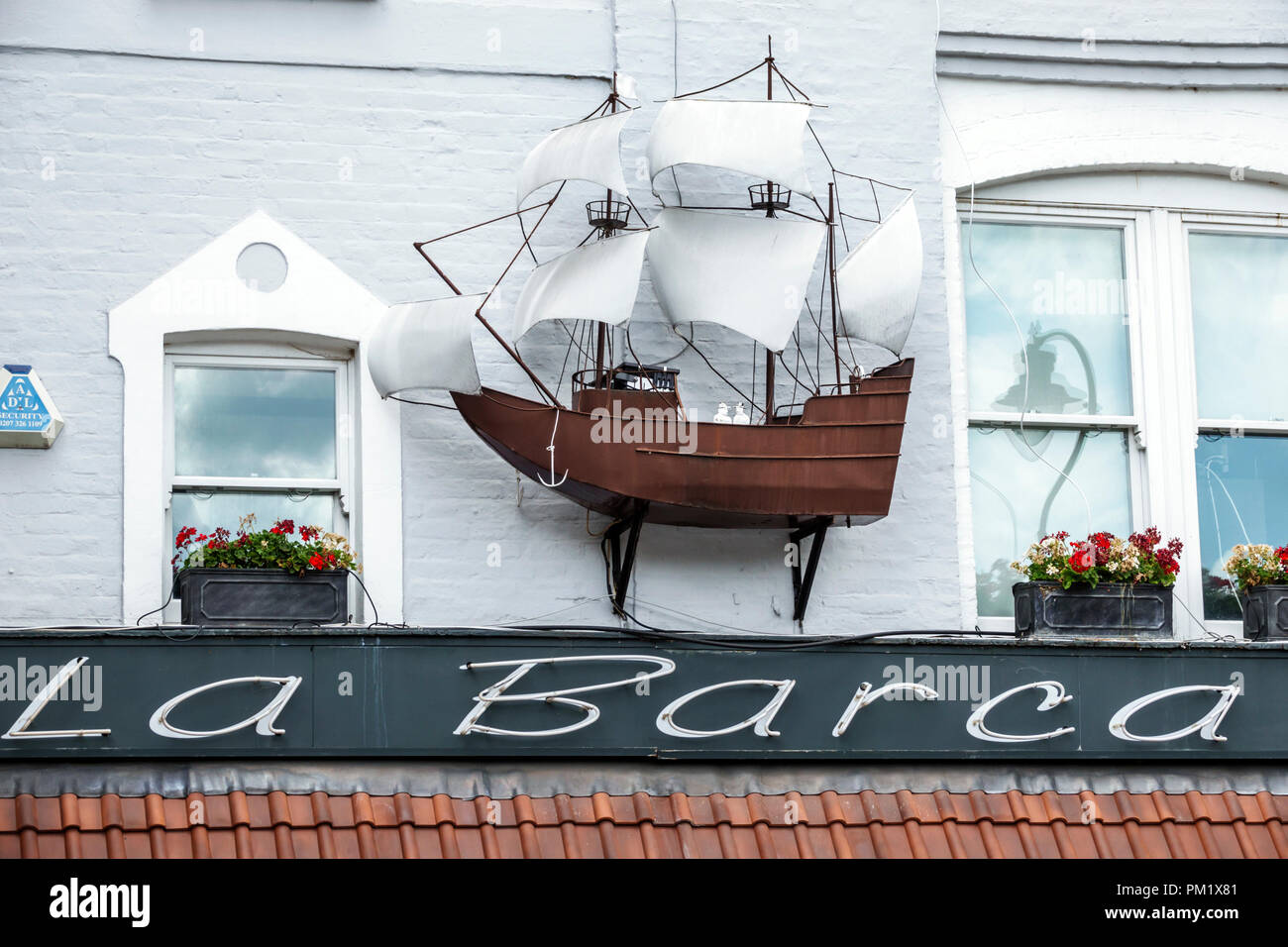 London England Great Britain United Kingdom South Bank Waterloo La Barca Ristorante Tuscan restaurant exterior illustrated sign antique model ship - Stock Image