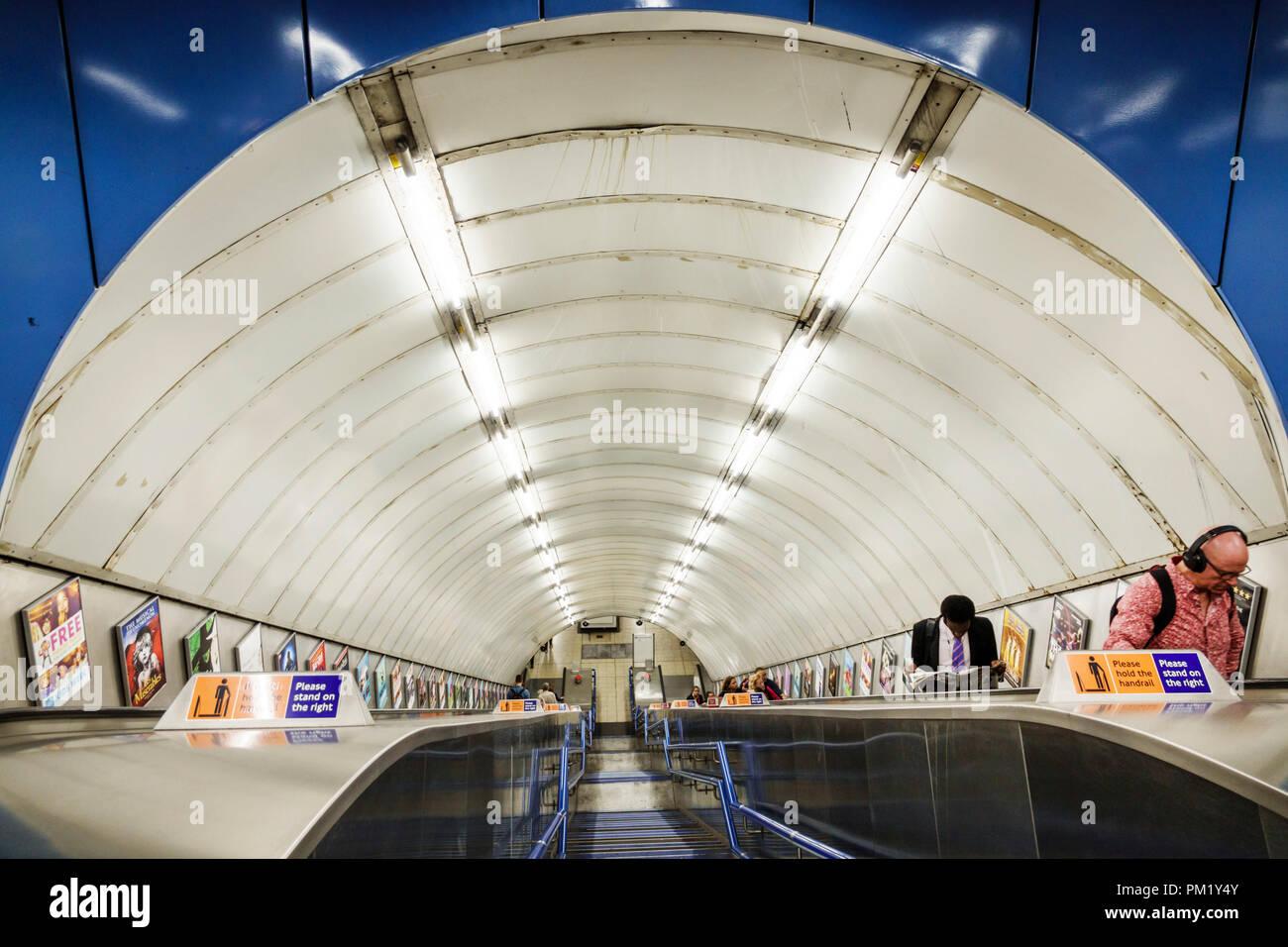 London England Great Britain United Kingdom Charing Cross Underground Station subway tube public transportation inside escalator man - Stock Image
