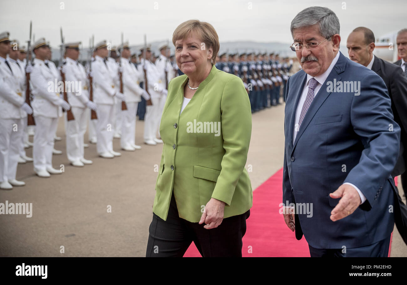 Algier, Algeria. 17th Sep, 2018. German Chancellor Angela Merkel (CDU) is welcomed at the airport by Algerian Prime Minister Ahmed Ouyahia with military honours. Credit: Michael Kappeler/dpa/Alamy Live News - Stock Image