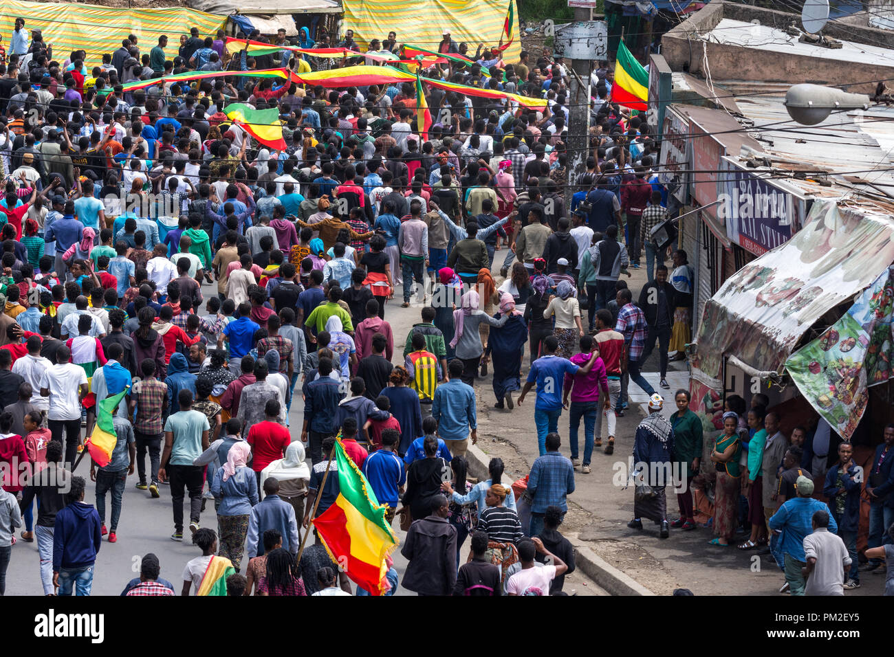 Addis Ababa, Ethiopia . 17th September 2018.  A large number of Addis Ababa residents and youth take to the streets of Piassa with the green, yellow, and red Ethiopian flag (without emblem) to protest the recent unrest in the city prior to and during the return of the Oromo Liberation Front (OLF) members. Credit: David Kirba/Alamy Live News - Stock Image