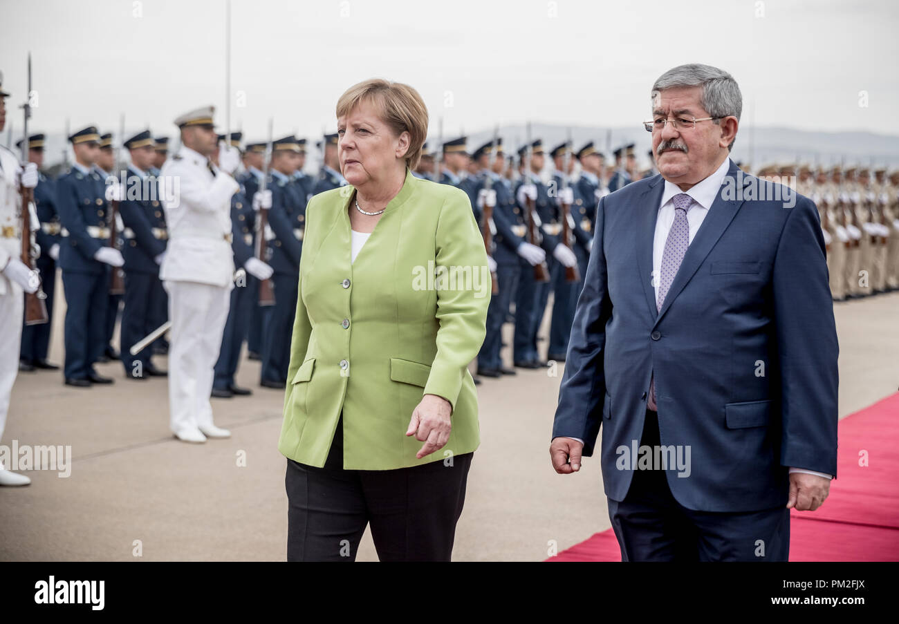 Algier, Algeria. 17th Sep, 2018. German Chancellor Angela Merkel (CDU) is welcomed at the airport by Algerian Prime Minister Ahmed Ouyahia (r) with military honours. Credit: Michael Kappeler/dpa/Alamy Live News - Stock Image