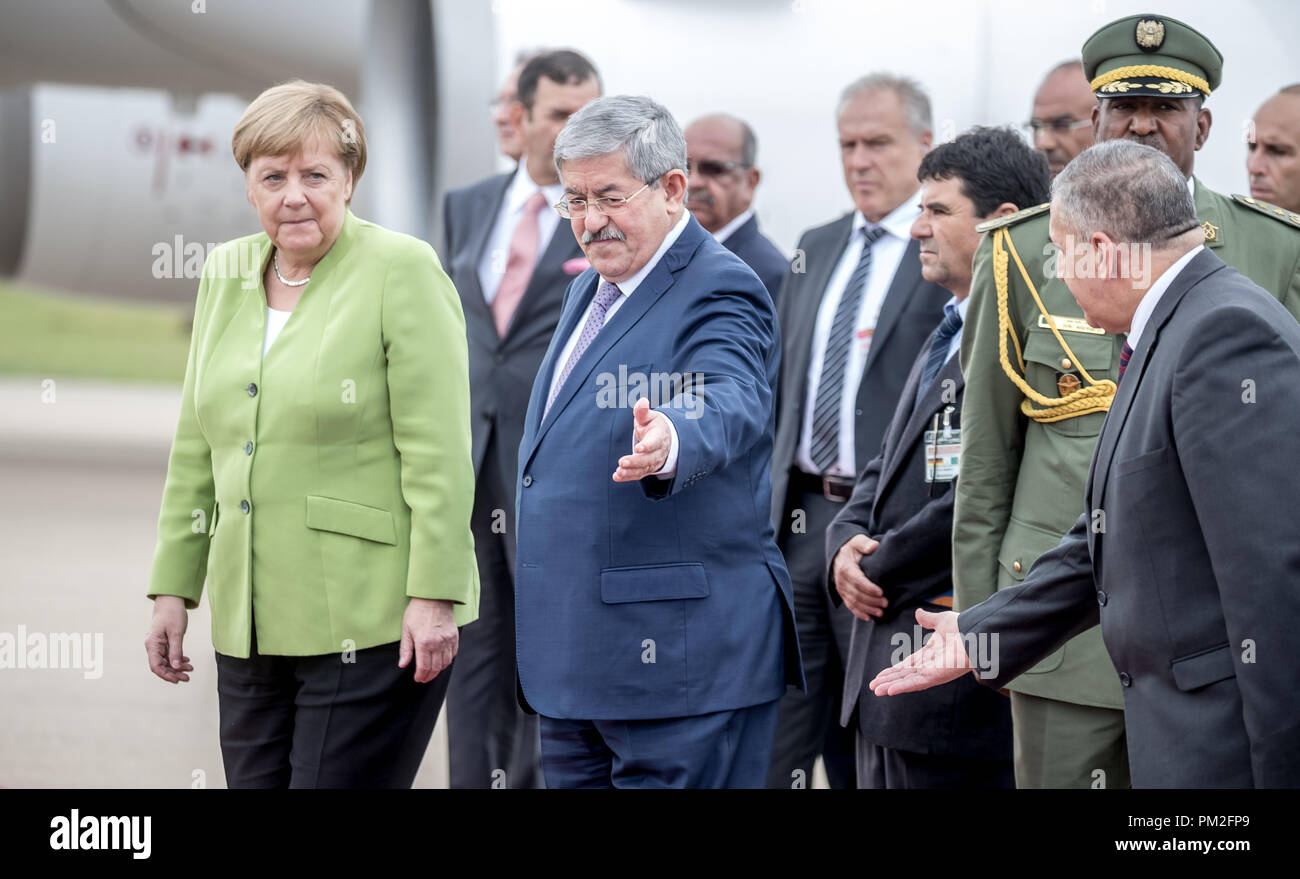 Algier, Algeria. 17th Sep, 2018. German Chancellor Angela Merkel (CDU) is welcomed at the airport by Algerian Prime Minister Ahmed Ouyahia (2nd from left) with military honours. Credit: Michael Kappeler/dpa/Alamy Live News - Stock Image
