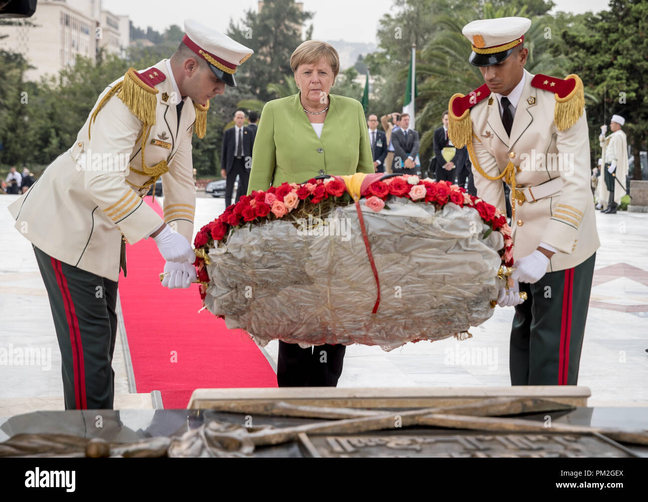 Algier, Algeria. 17th Sep, 2018. Chancellor Angela Merkel (CDU) is laying a wreath at the monument to the dead in the fight for independence Riad El Feth. Credit: Michael Kappeler/dpa/Alamy Live News - Stock Image