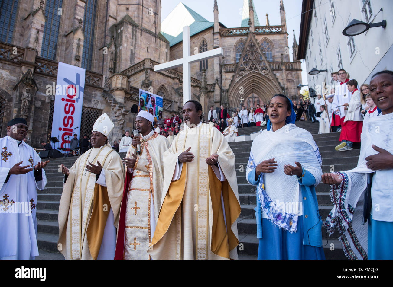 Erfurt, Thuringia. 16th Sep, 2018. Representatives of the church from Ethiopia sing at the opening of the nationwide relief action of the International Catholic Missionswerkes missio on the occasion of the diocese pilgrimage on the steps of Erfurt Cathedral. Credit: Jens-Ulrich Koch/dpa-Zentralbild/dpa/Alamy Live News - Stock Image