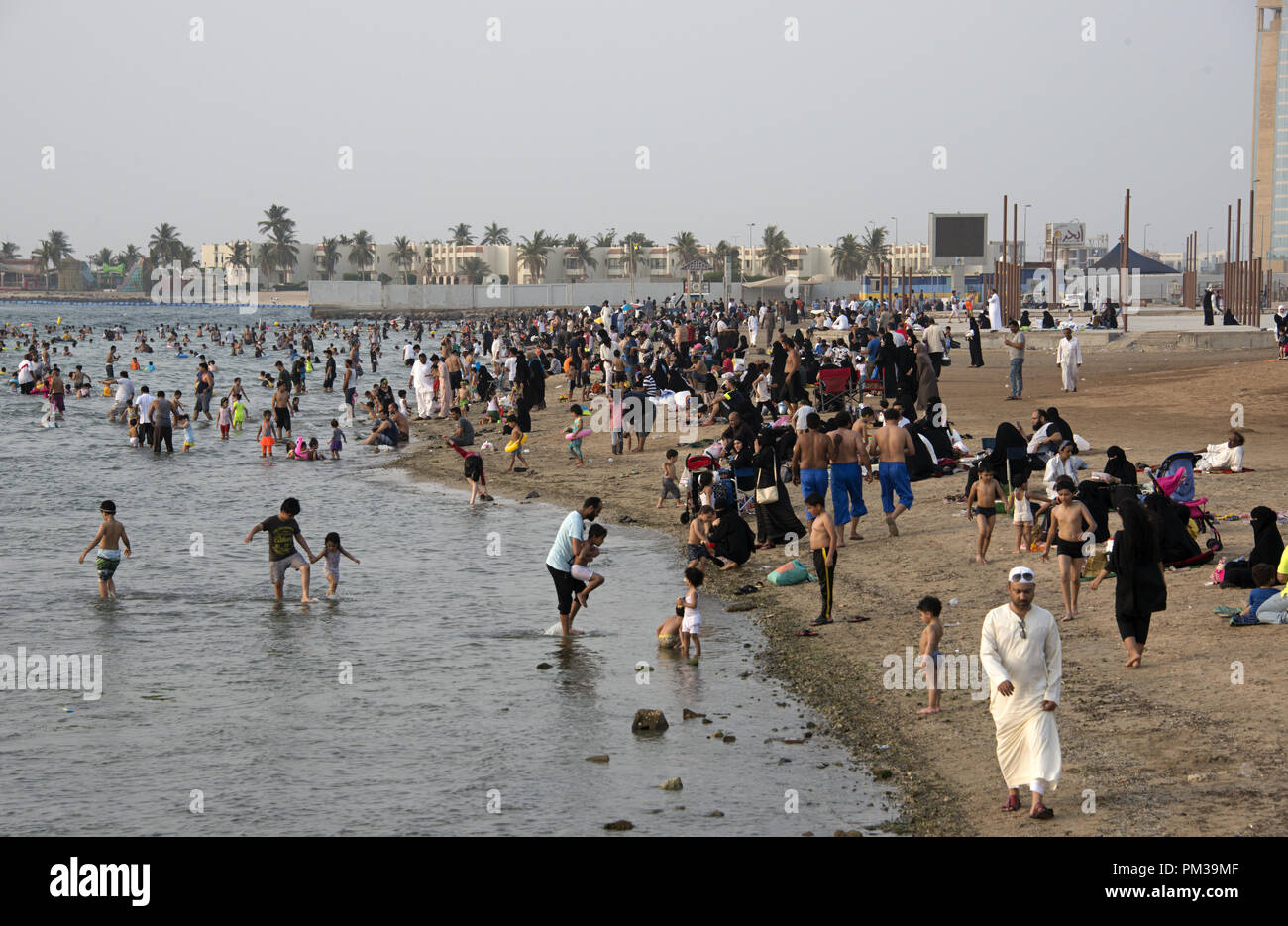 Saudi families gathered by a public Red Sea beach in Jeddah, Saudi Arabia - Stock Image