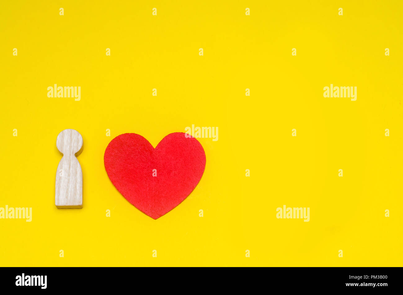 Concept And Symbol Of Love Wooden Man And Heart On A Yellow