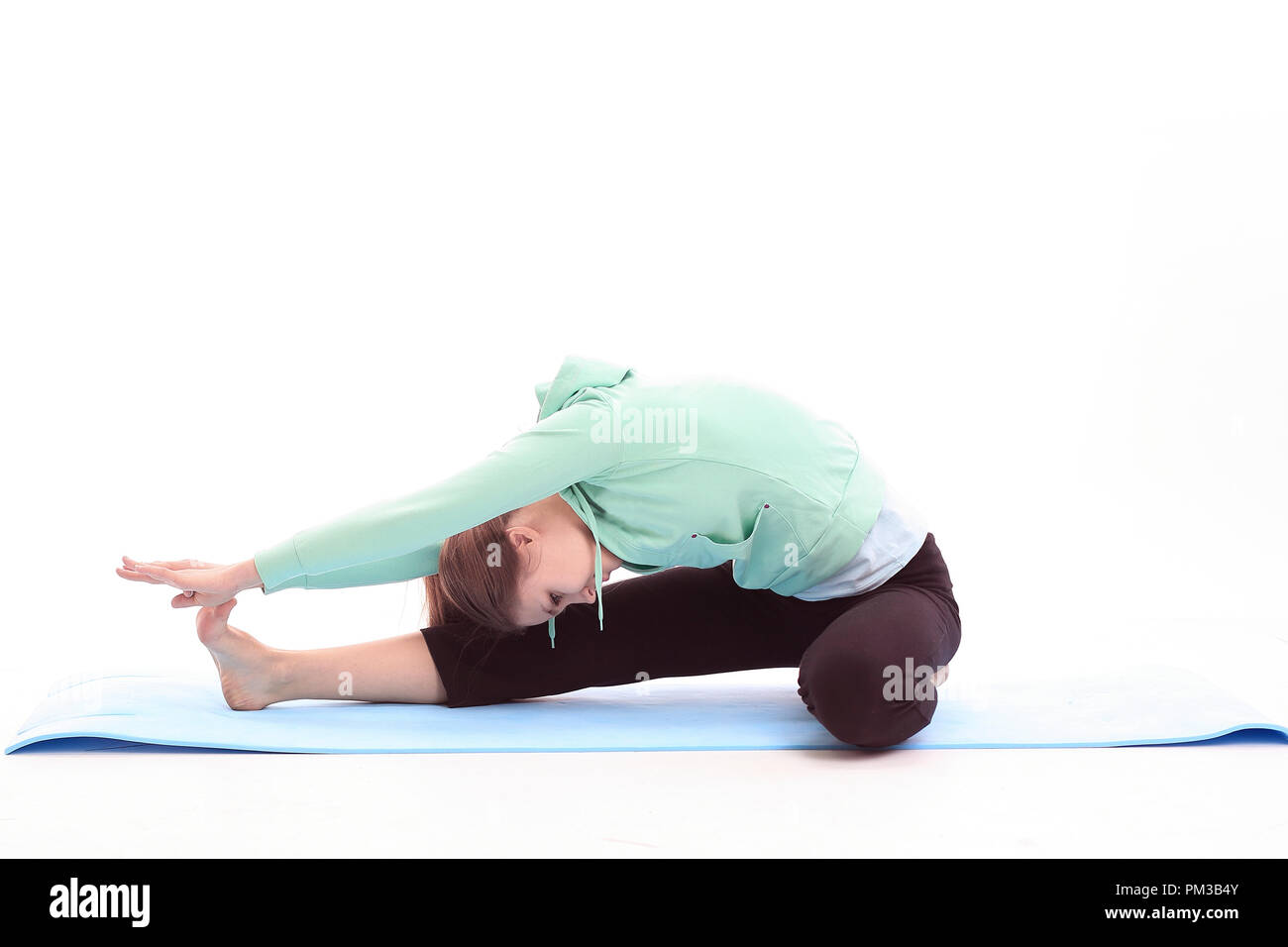 fitness trainer doing stretching exercise of the muscles. - Stock Image