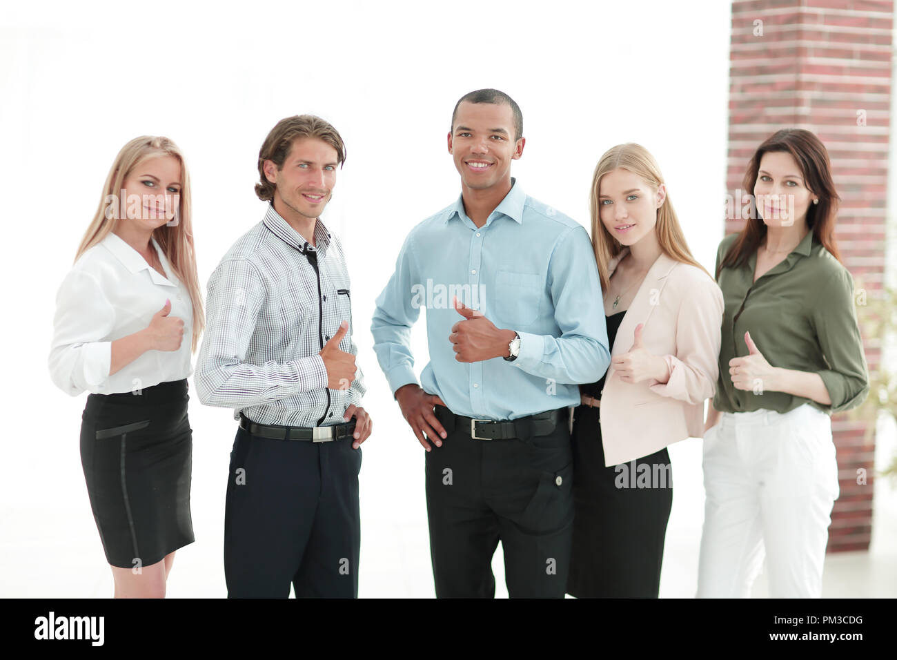 successful multinational business team showing thumb up - Stock Image