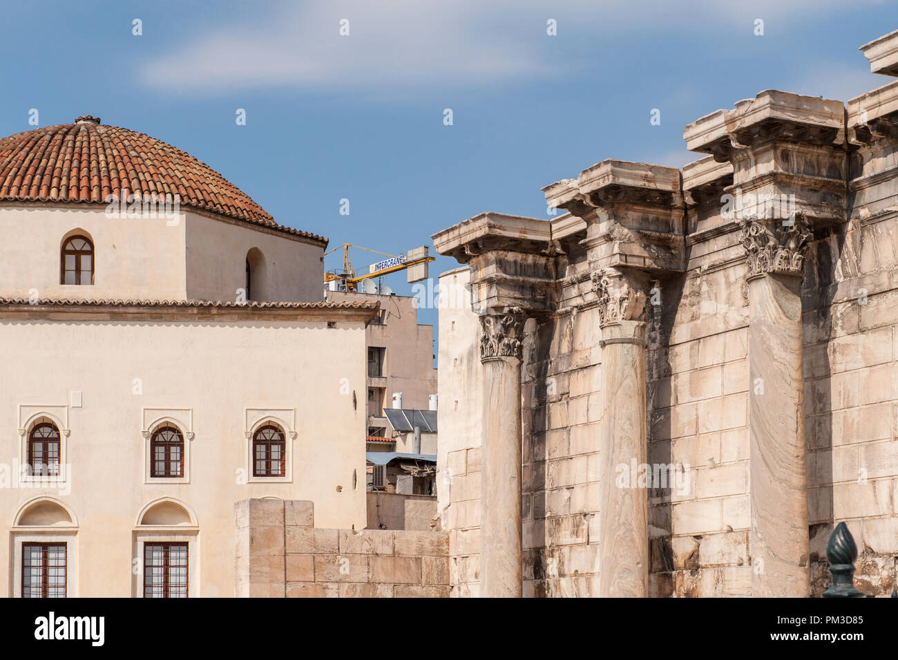 Library of Hadrian (right) located in the north corner of the ancient Agora of Athens. Roman emperor Hadrian built the library in AD 132. - Stock Image
