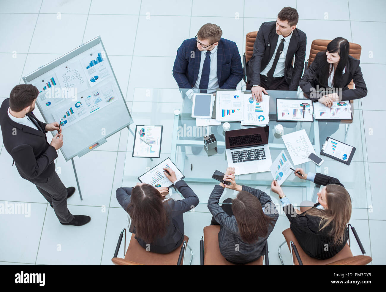 presentation of a new financial project on a workplace at office - Stock Image