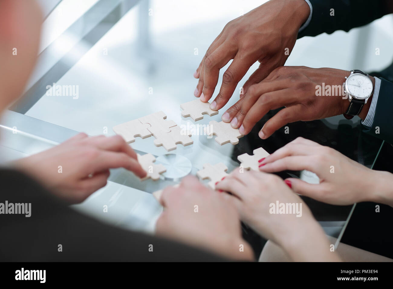 close up. business team assembling puzzle pieces. - Stock Image