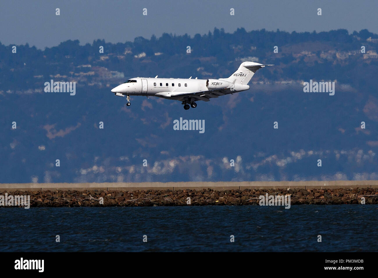 Bombardier Challenger 300 (N578XJ) operated by Xojet landing at San Francisco International Airport (KSFO), San Francisco, California, United States of America - Stock Image