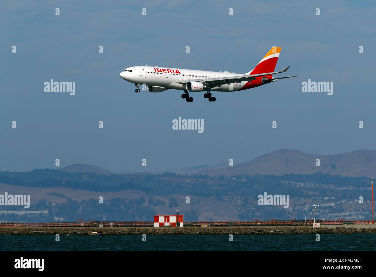 Airbus A330-202 (EC-MLP) operated by Iberia landing at San Francisco International Airport (KSFO), San Francisco, California, United States of America - Stock Image