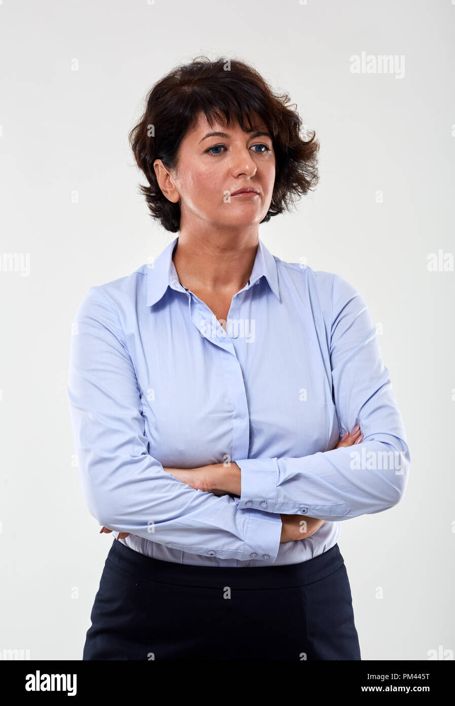Portrait of a mature businesswoman with an expression of distrust - Stock Image
