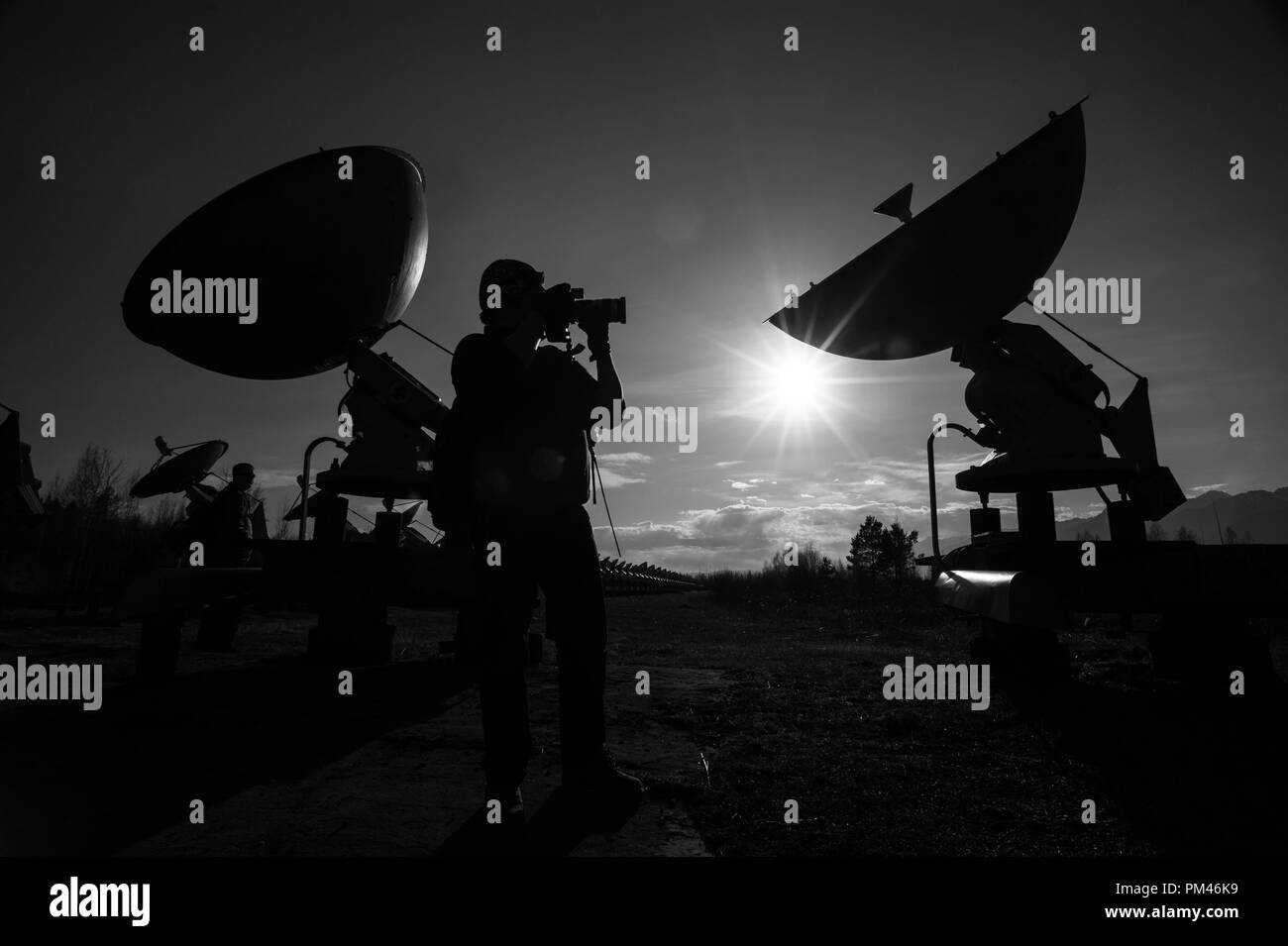 Satellite dishes on summit at sun day. - Stock Image