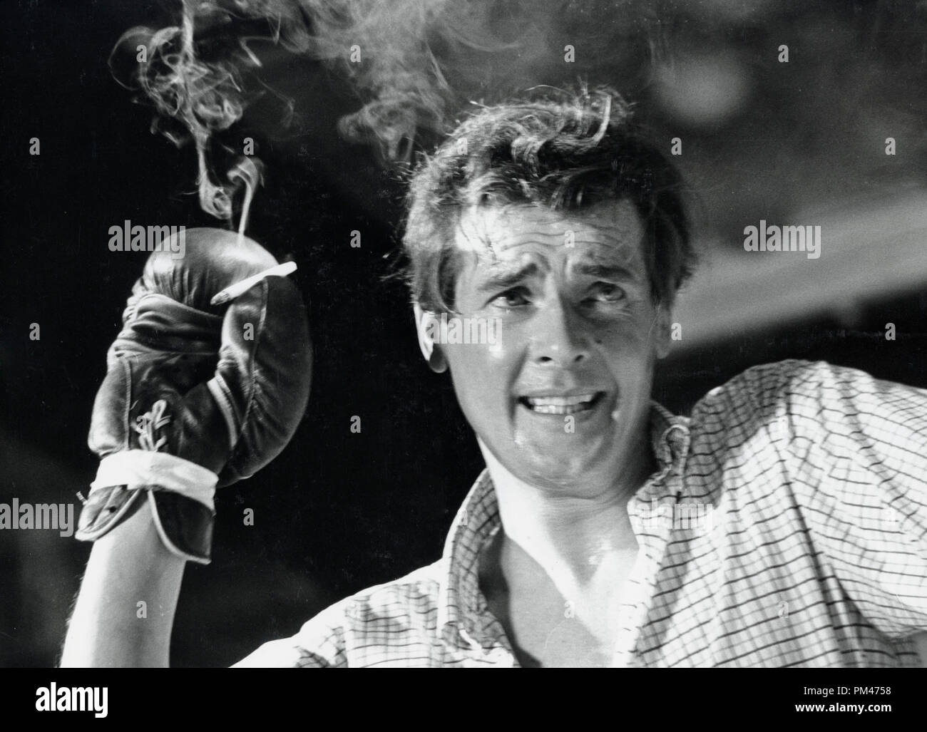 Roger Moore during a fight scene for the TV series, 'The Saint' circa 1966.   File Reference # 1102_003THA © JRC /The Hollywood Archive - All Rights Reserved - Stock Image