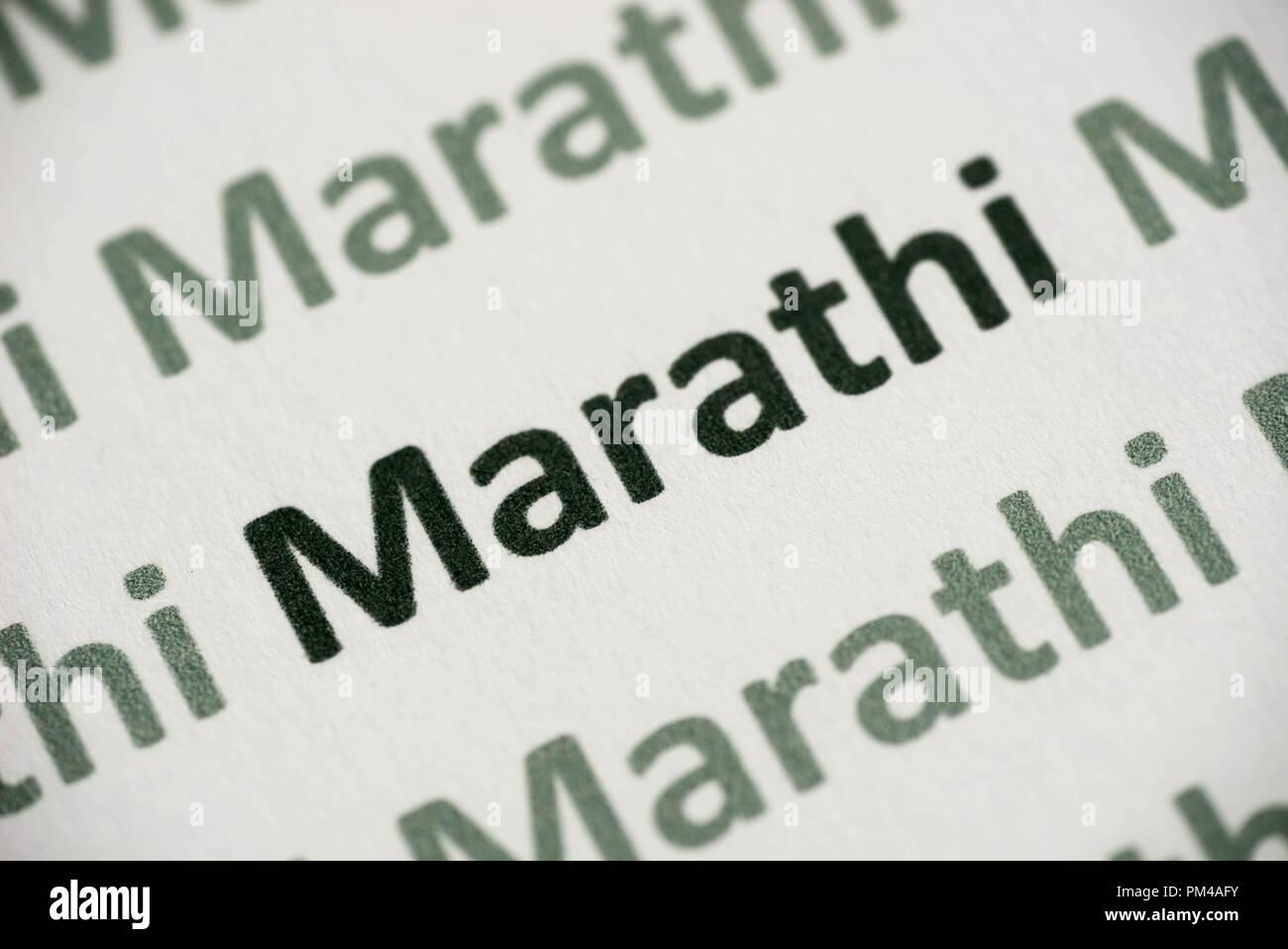 word Marathi  language printed on white paper macro - Stock Image