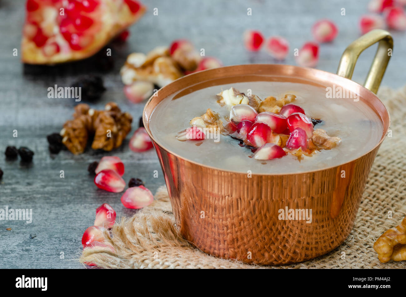 According to Islam, the tenth day of the month of Muharram. When Noah came ashore after the Great Flood, he made this dessert with the last ingredient - Stock Image