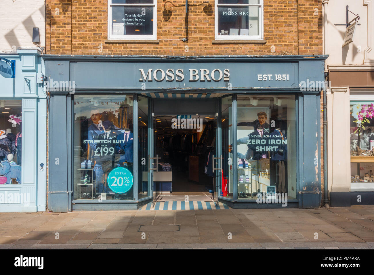 the moss Bros men's fashion store on Peascod Street in Windsor, UK. - Stock Image