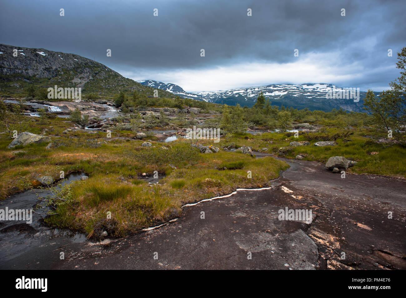 The summer view of Trolltunga in Odda, Ringedalsvatnet lake, Norway. - Stock Image
