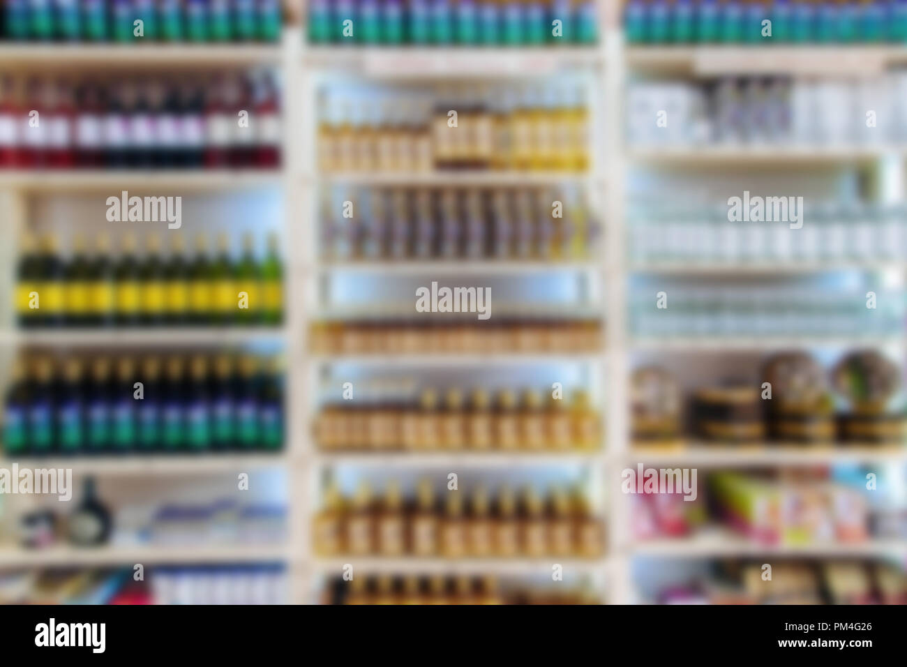 fridge with drinks and products in the supermarket blurred background - Stock Image