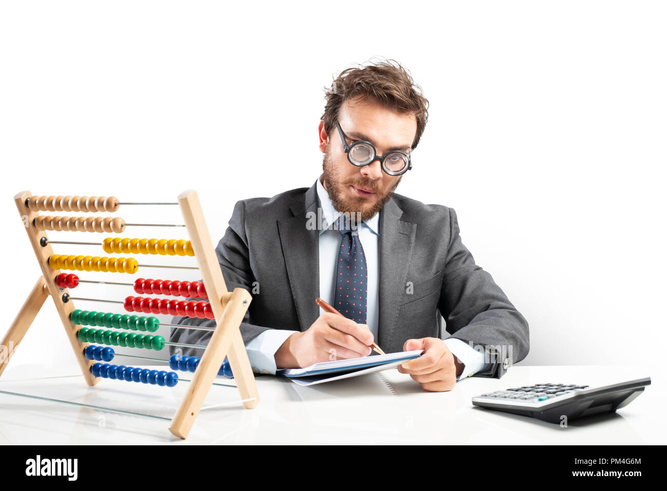 Nerd accountant does calculation of company revenue - Stock Image