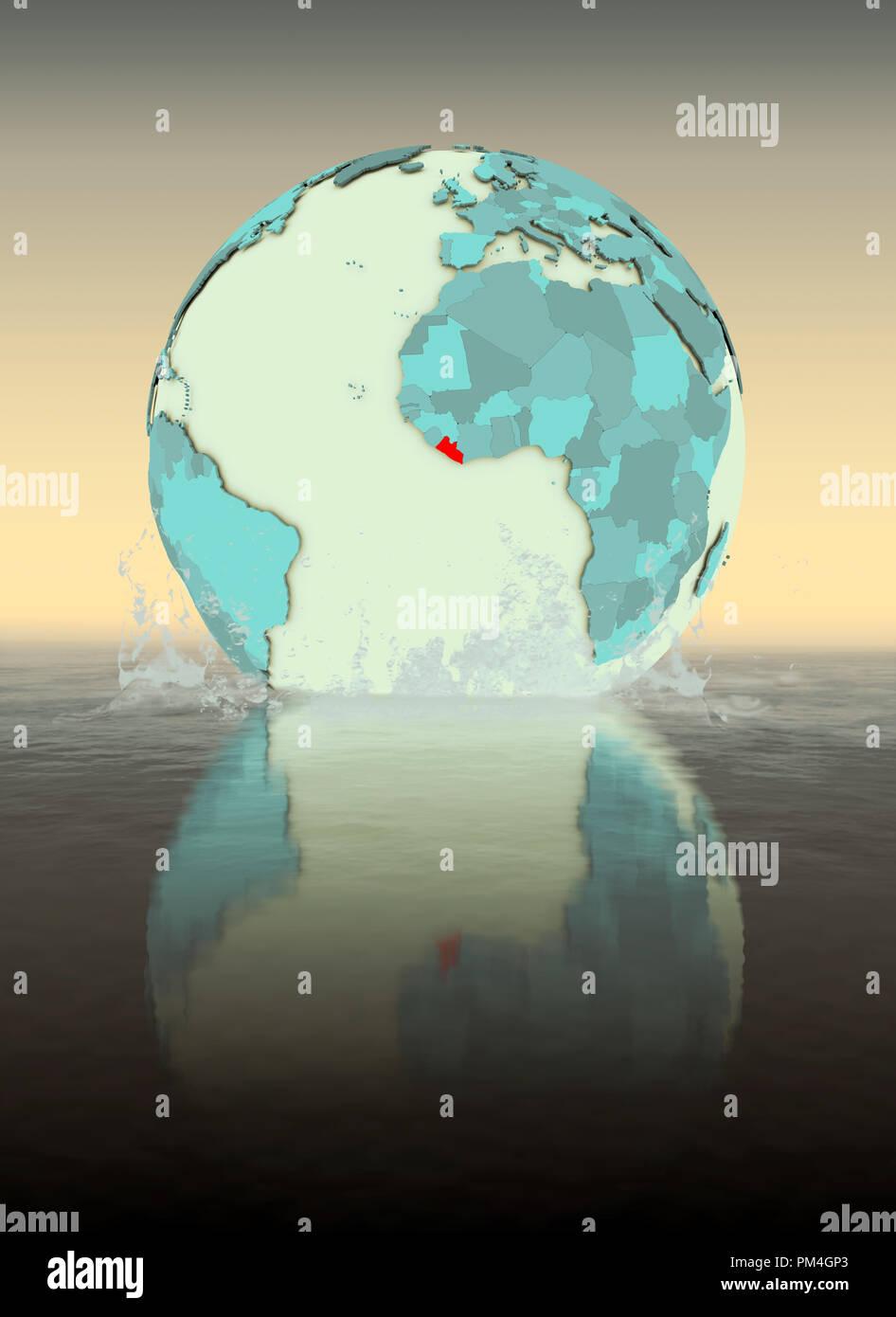 Liberia on globe splashed into the water. 3D illustration. - Stock Image