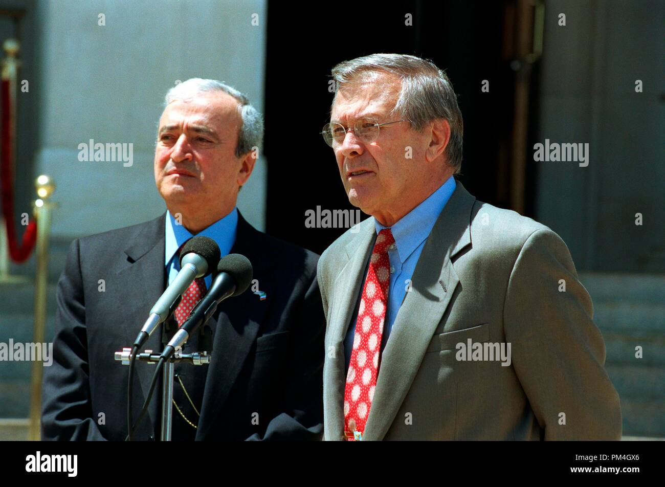 Secretary of Defense Donald H. Rumsfeld (right) responds to reporter's question during a joint press conference with Italian Minister of Defense Antonio Martino at the Pentagon on May 10, 2002. Rumsfeld and Martino met earlier to discuss defense issues of mutual interest. DoD photo by Helene C. Stikkel. (Released) Date: September 19, 2010  File Reference # 1003_129THA - Stock Image
