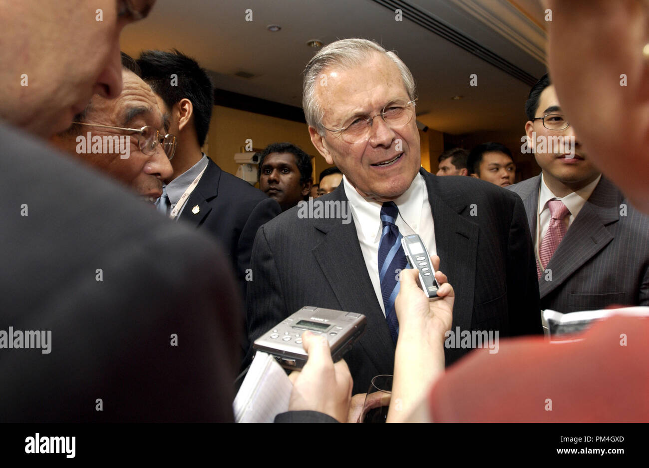 Secretary of Defense Donald H. Rumsfeld speaks with members of the press at the opening reception of the 4th International Institute for Strategic Studies Asia Security Conference: The Shangri-La Dialogue in Singapore on June 3, 2005.  The Asia Security Conference brings ministers of defense and other senior officials of Pacific nations together to discuss such topics as terrorism, piracy and defense capabilities in the region.  DoD photo by Tech. Sgt. Cherie A. Thurlby, U.S. Air Force.  (Released)  File Reference # 1003_133THA - Stock Image