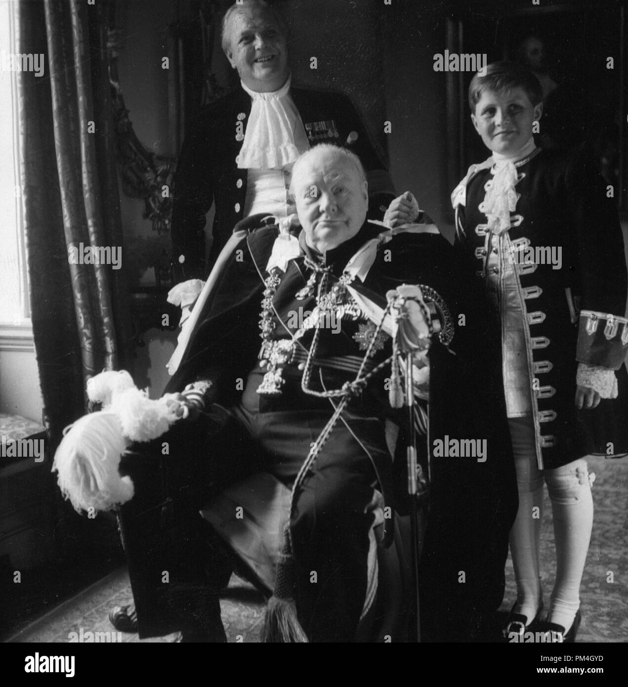 Sir Winston Churchill, his son Randolf [i.e., Randolph], and grandson, Winston in coronation robes, circa 1950s. photo by Toni Frissell  File Reference # 1003_148THA - Stock Image