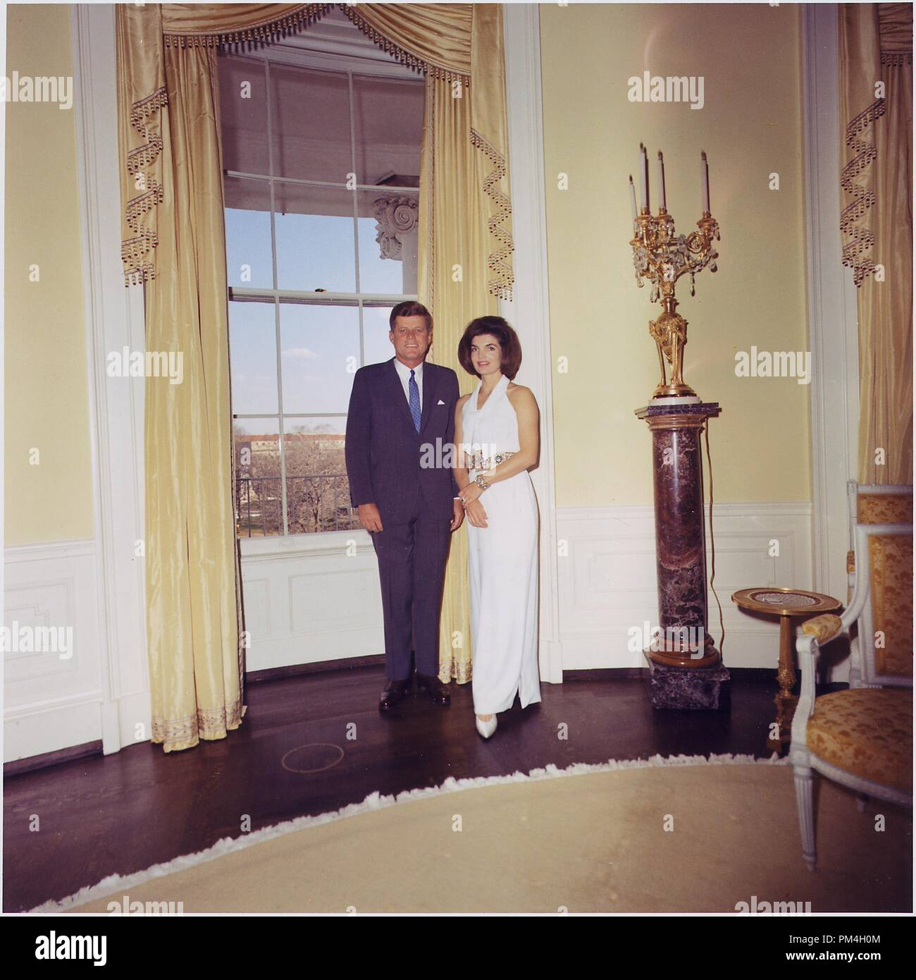 President and First Lady, Portrait Photograph. President John F. Kennedy, Mrs. Jacqueline Kennedy. White House, Yellow Oval Room, 28 March 1963   File Reference # 1003_166THA - Stock Image