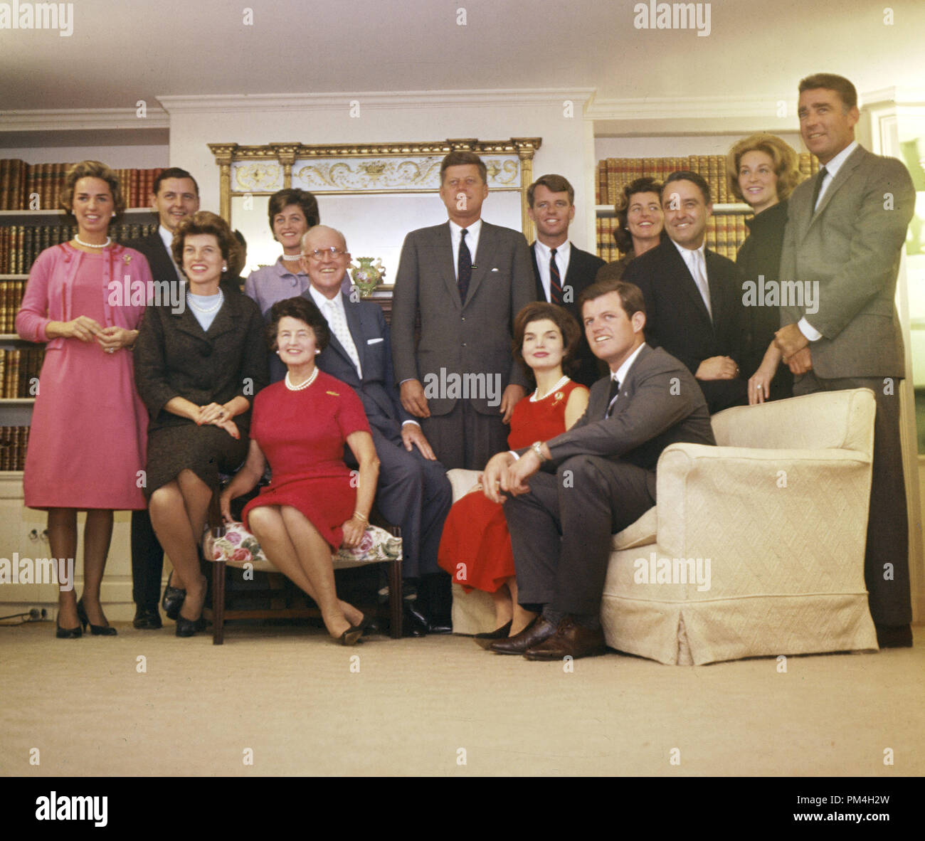 Kennedy Family Portrait. The Kennedy family in the home of Joseph P. Kennedy on Nov. 9, 1960. Standing, left to right: Ethel Skakel Kennedy, Steve Smith, Jean Kennedy Smith; President-elect John F. Kennedy, Robert F. Kennedy, Patricia Lawford, Sargent Shriver, Joan Bennett Kennedy and Peter Lawford. In foreground, left to right: Eunice Kennedy Shriver, Rose Kennedy, Joseph P. Kennedy, Jacqueline Bouvier Kennedy and Edward M. Kennedy. Courtesy JFK Library  File Reference # 1003_196THA - Stock Image