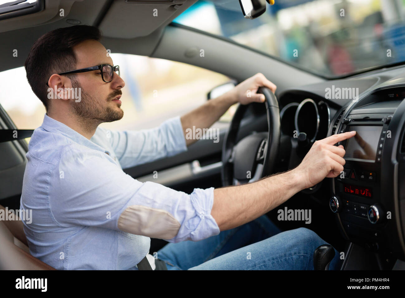 Man Using Gps Navigation System In Car Stock Photo