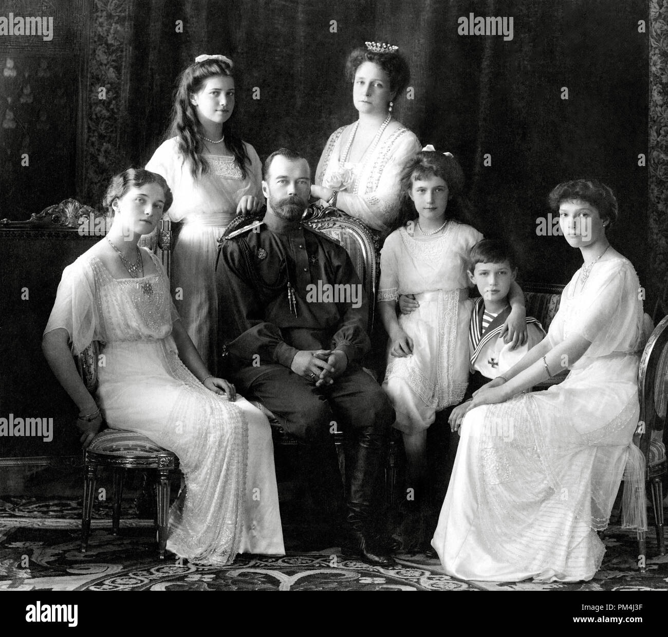 Emperor Nicholas II of Russia with the family (left to right): Olga, Maria, Nicholas II, Alexandra Fyodorovna, Anastasia, Alexei, and Tatiana. Livadiya, 1913. Portrait by the Levitsky Studio, Livadiya.  File Reference # 1003_498THA - Stock Image