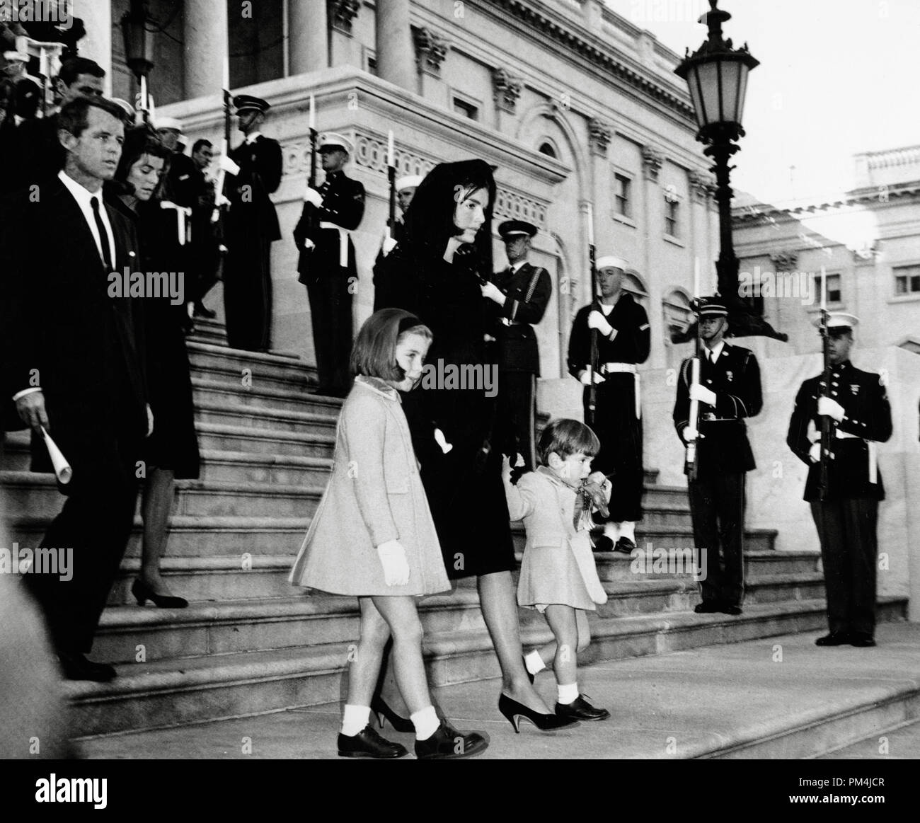 The coffin of assassinated American President John F. Kennedy (off camera)  is carried down the steps at St Matthew's Cathedral, Washington, after the requiem mass. Following the coffin is his widow Jacqueline Bouvier Kennedy, their children Caroline and John Jr. and Robert Kennedy, November 25, 1963   File Reference # 1003_670THA - Stock Image