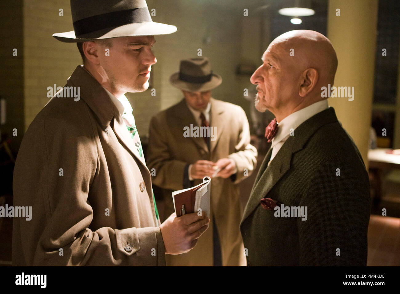 """(Left to right) Teddy Daniels (Leonardo DiCaprio) and Chuck Aule (Mark Ruffalo) discuss their suspicions about the mysterious disappearance on an island prison for the criminally insane with Dr. Cawley (Ben Kingsley) in the thriller """"Shutter Island."""" - Stock Image"""