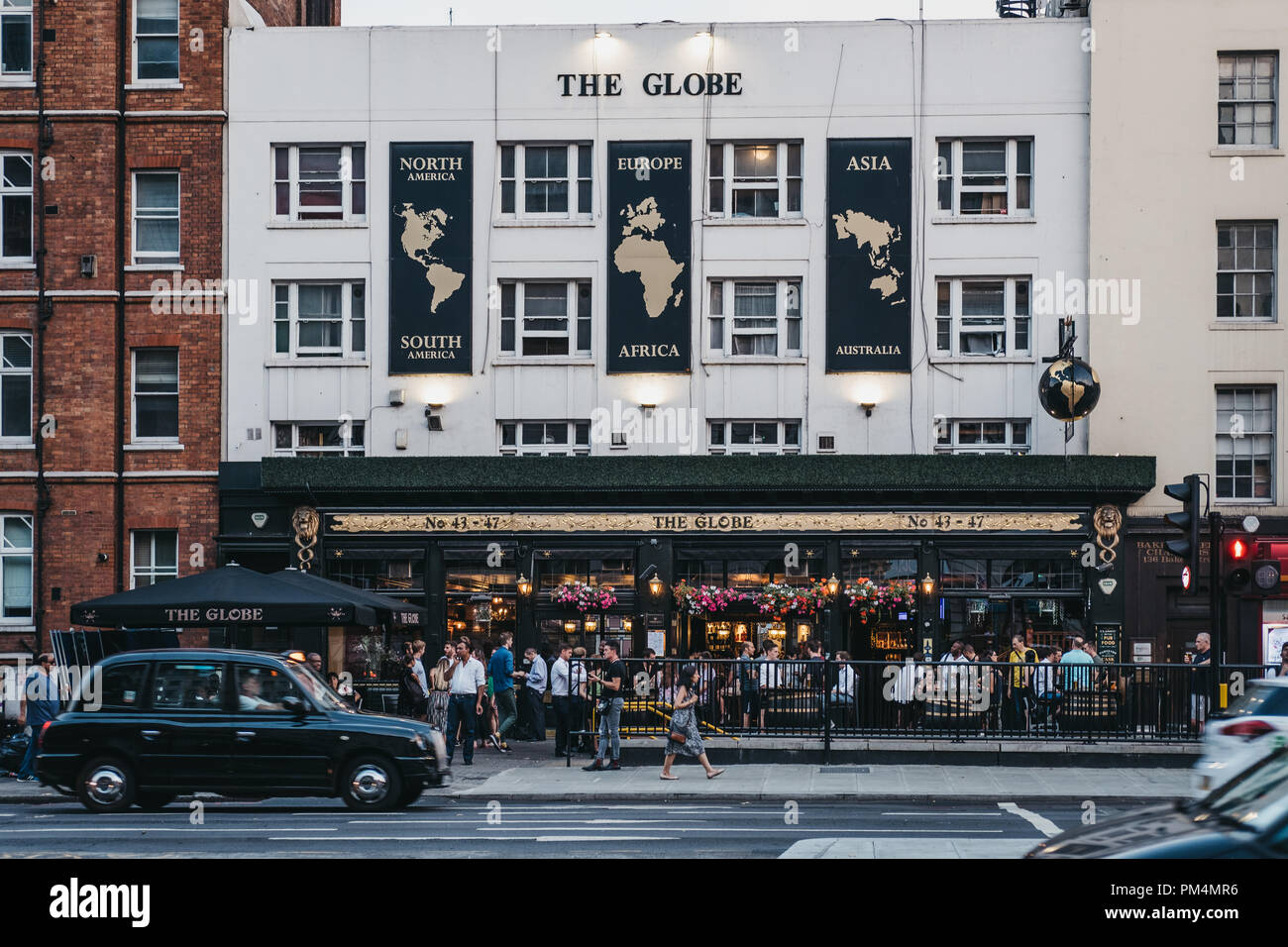London, UK - July 24, 2018: People drinking outside The Globe pub in Marylebone, London, the area famous for Madame Tussauds waxwork museum and the Sh Stock Photo