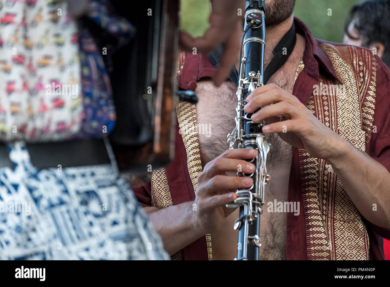 Close up of clarinet and accordion players from the Don Kipper band playing at a Klezmer concert of Jewish  music in Regent's Park, London UK. - Stock Image