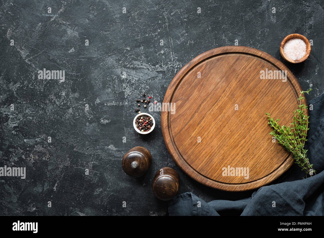 Spices Herbs Cutting Board For Cooking Round Wooden Cutting Board On Black Concrete Backdrop Top View With Copy Space For Text Menu Recipe Mock Stock Photo Alamy