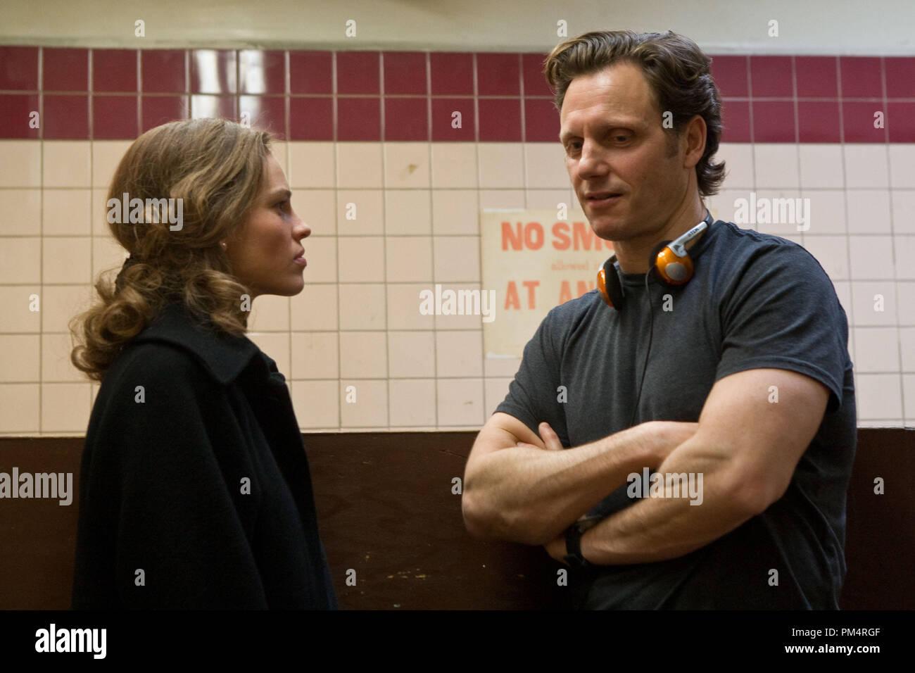 Hilary Swank and Director Tony Goldwyn on the set of CONVICTION; Photo by Ron Batzdorff 2010 - Stock Image