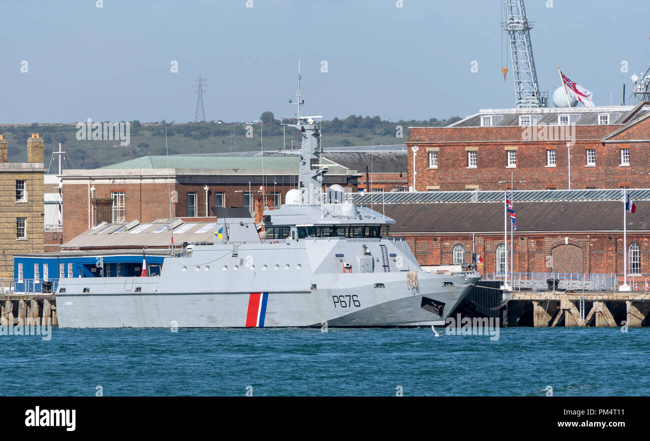 French navy vessel P676 Flamant. A search and rescue and fisheries patrol boat alongside in Portsmouth Naval base. - Stock Image