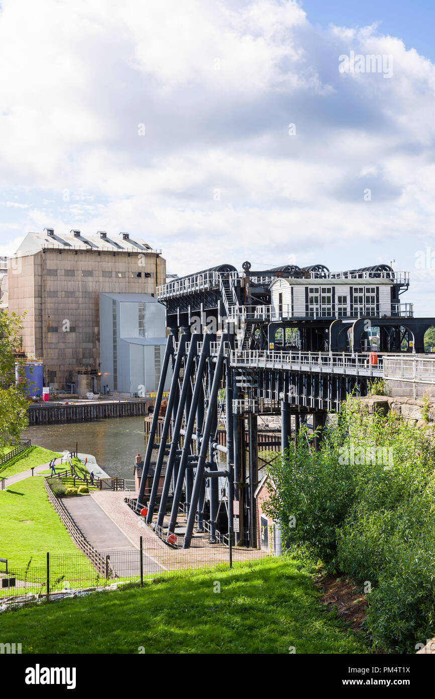 Higher level view of the Anderton Boat lift and River Weaver from the higher ground supporting a spur of the Trent & Mersey canal in Northwich Cheshir - Stock Image