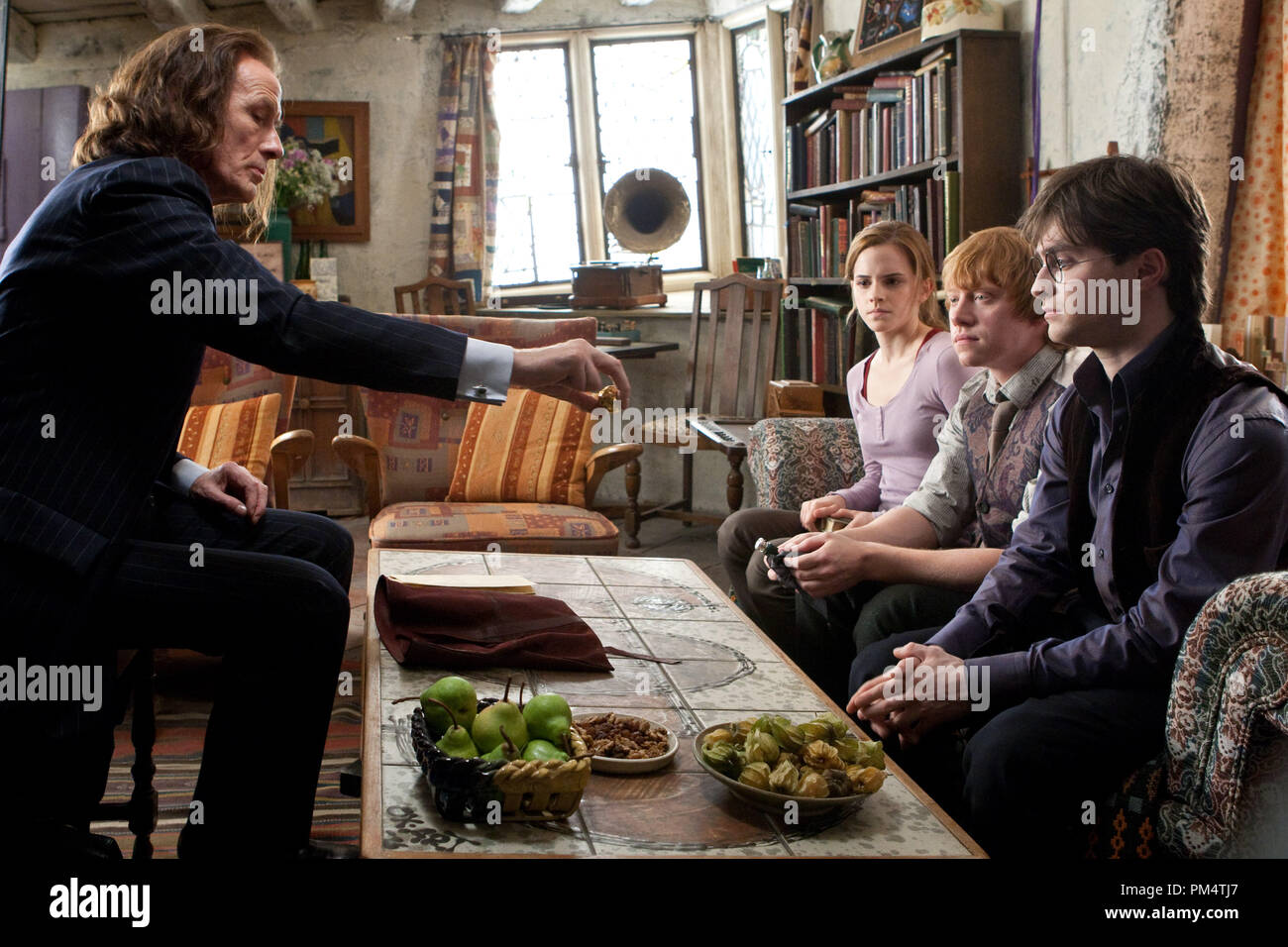 (L-r) Bill Nighy as Rufus Scrimgeour, EMMA WATSON as Hermione Granger, RUPERT GRINT as Ron Weasley and DANIEL RADCLIFFE as Harry Potter in Warner Bros. PicturesÕ fantasy adventure ÒHARRY POTTER AND THE DEATHLY HALLOWS Ð PART 1,Ó a Warner Bros. Pictures release.    Photo by Jaap Buitendijk - Stock Image