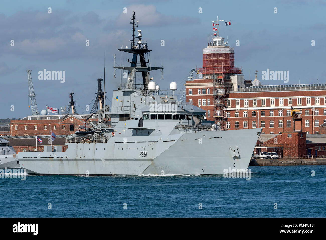 HMS Tyne departing Portsmouth Harbour to patrol the offshore fishing areas  of the English Channel. - Stock Image