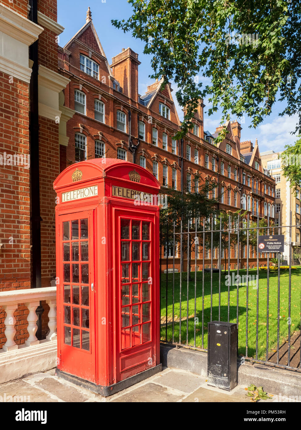 LONDON:  Red Telephone Box in South Audley Street - Stock Image