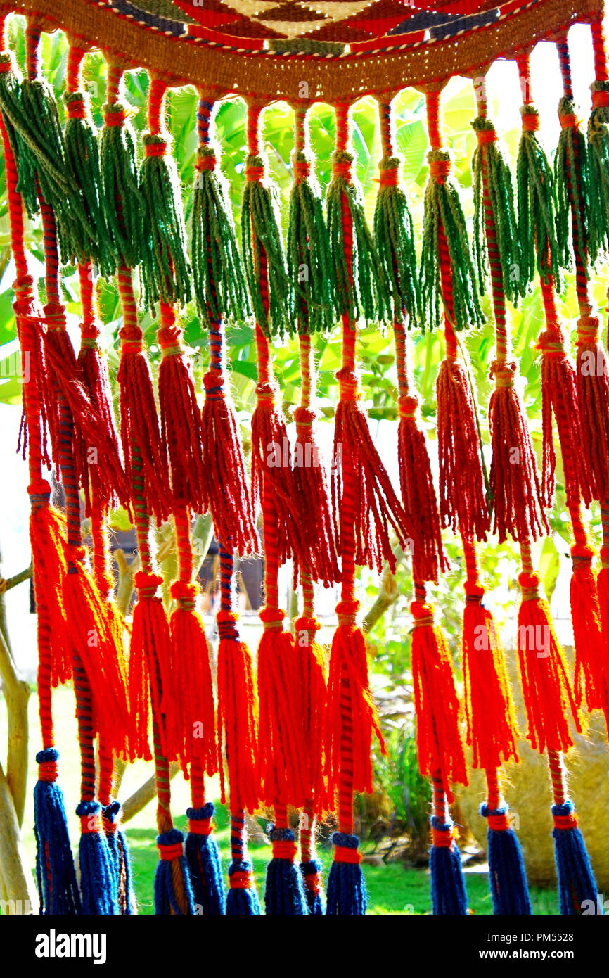 Colourful Curtains. Rope colourful curtain abstract background - Stock Image