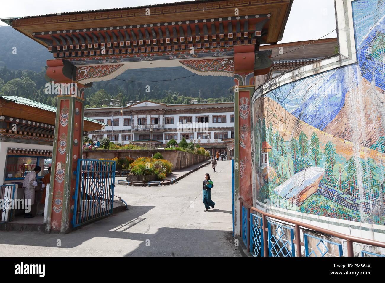 Bhutanese student outside Gaeddu College of Business Studies in Thimphu Bhutan. - Stock Image