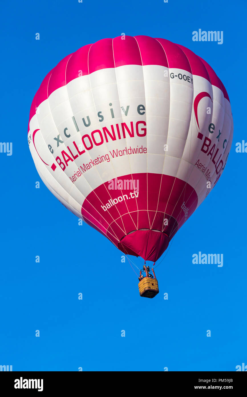 Exclusive ballooning hot air balloon in the sky at Longleat Sky Safari, Wiltshire, UK in September - Stock Image