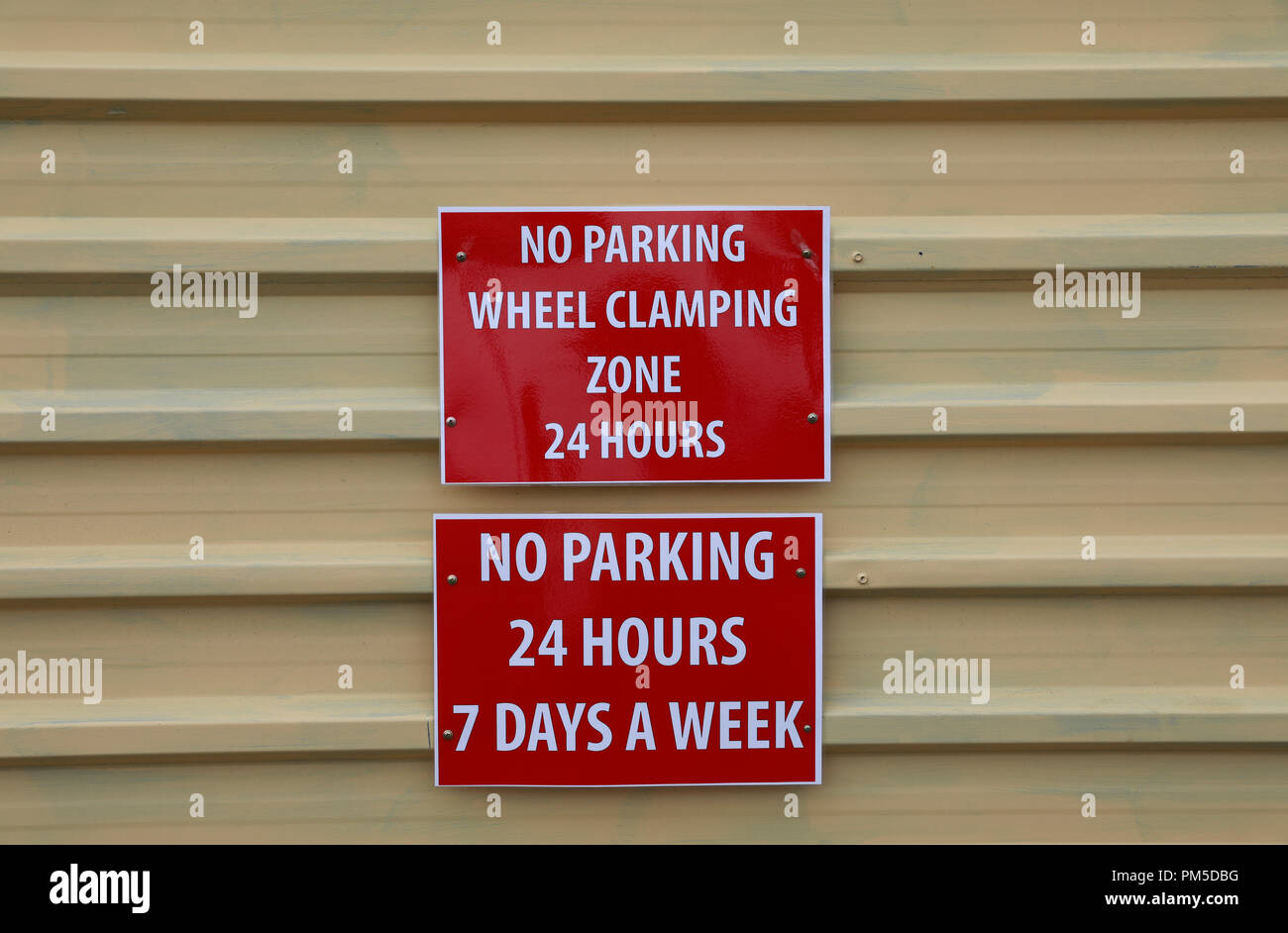 No Parking signs on garage door , Sea Point, Cape Town, South Africa. - Stock Image